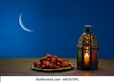 The Muslim feast of the holy month of Ramadan Kareem. Beautiful background with a shining lantern Fanus. Free space for your text