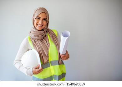 Muslim female architect. Arab architect are planning new project. Muslim female construction engineer. Portrait of Arab architect. Muslimah pretty girl. Female muslim engineer with headscarf