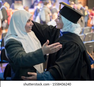 Muslim female student on graduation ceremony with proud mom