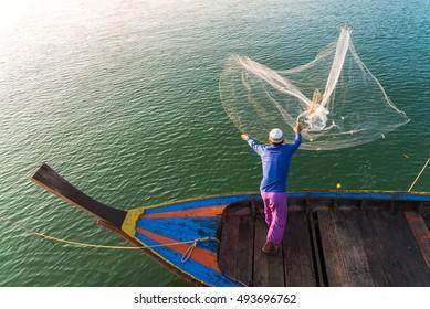 Muslim Fisherman Fishing Nets