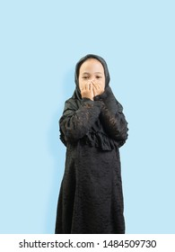 Muslim Girl in a dress Seeking blessings to God , isolate background  .
