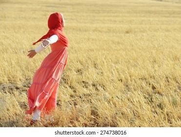 Muslim girl enjoying in nature