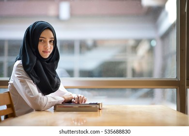 Muslim girl student in the library.