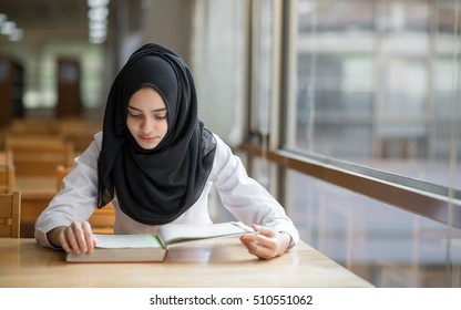 Muslim Girl Student Studying At The Library
