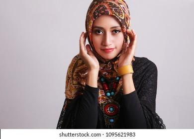 muslim girls in hijab looking camera. Young asian muslim woman in head scarf smile.