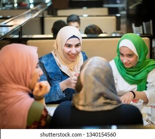 Muslim girls at restaurant having iftar