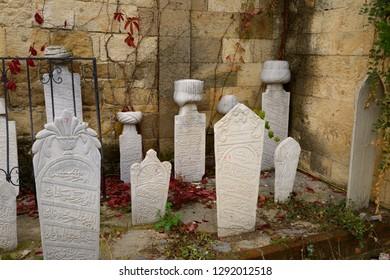 Muslim gravestones next to a Mosque in hillside village of Yesilyurt, Malatya, Turkey - November 11, 2012