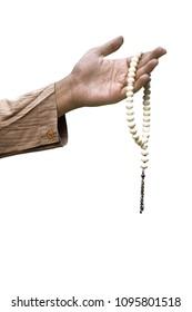 Muslim hand holding prayer beads isolated over white background
