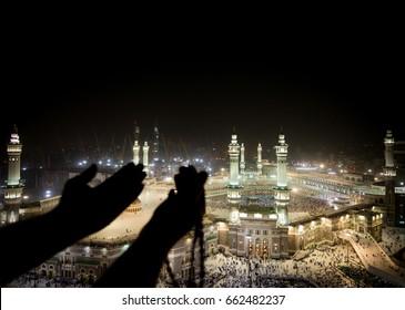 Muslim hands praying in Kaaba