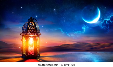 Muslim Holy Month Ramadan Kareem - Ornamental Arabic Lantern With Burning Candle Glowing At Evening
