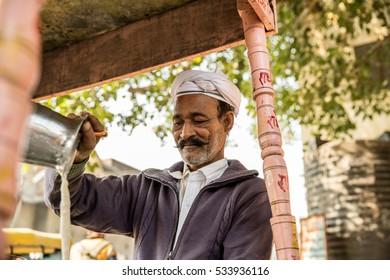 Muslim Indian preparing Masala Tea.