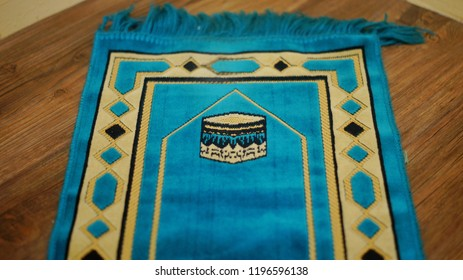 Muslim islamic praying mat on wooden floor