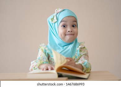Muslim kid reading the book in the class. Education concept