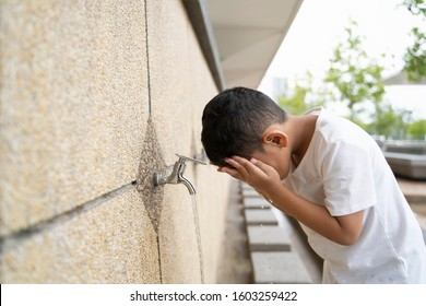 Muslim Kid takes ablution before   perform a prayer