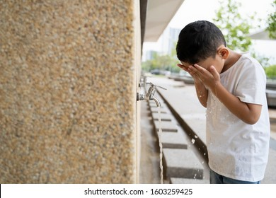 Muslim Kid takes ablution before prayer