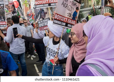Muslim ladies take selfie photographs during the Al Quds Day rally, London, 10/06/18.