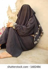 a muslim lady sitting in a village in india