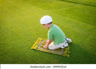 Muslim little kid praying