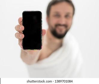 Muslim male pilgrim with mobile phone