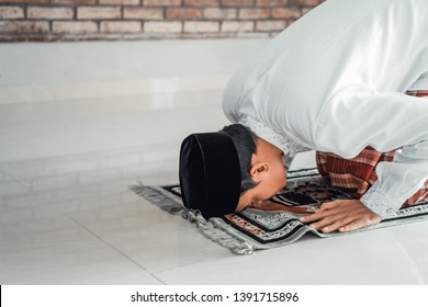 muslim male sujud. asian man praying or solat in islam