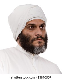 Muslim man with beard and turban isolated on white