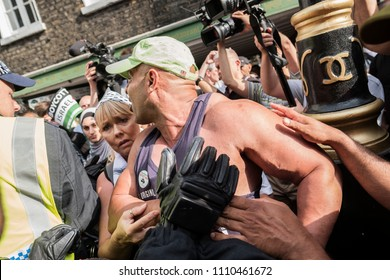 A Muslim man has a heated argument with an opposition protester and has to be moved on by the police during the Al Quds Day rally, London, 10/06/18.