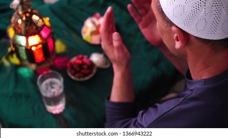 Muslim man in the Holy month of Ramadan. Dua (prayer) for breaking fast and beginning fast. Food and water. Praying, Islam, Religion