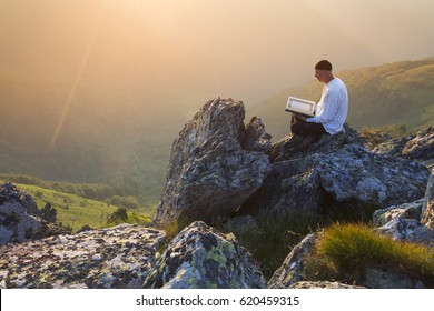 Muslim man pray in nature at sunset time
