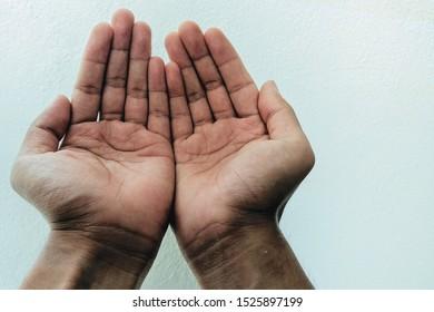 Muslim man praying on white background. copy space.