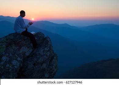 Muslim Man Praying Sunset Background