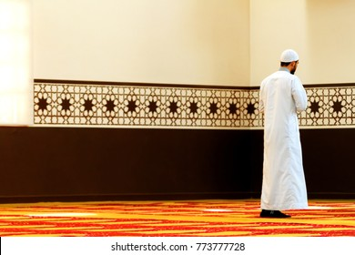 Muslim man prays standing in a mosque in Buenos Aires