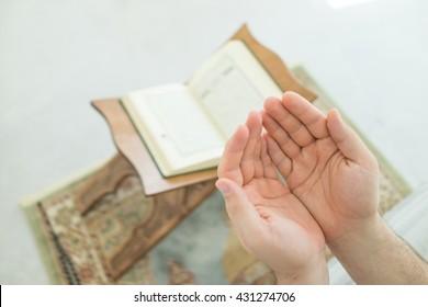 a muslim man is reading quran.