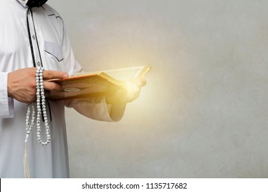 muslim man reading a Quran on gradient background, in Islam study. 