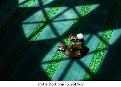 Muslim man recite his dua after performing his prayer