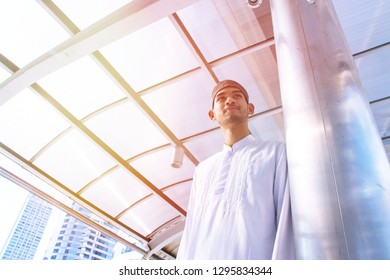 Muslim man is standing alone in the town