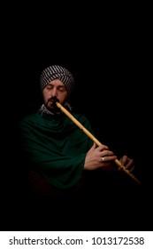 Muslim man with turban playing ney - Traditional sufi music