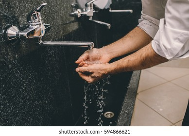 Muslim man washing his hands
