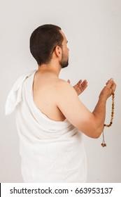 Muslim man wearing hajj cloth, studio image