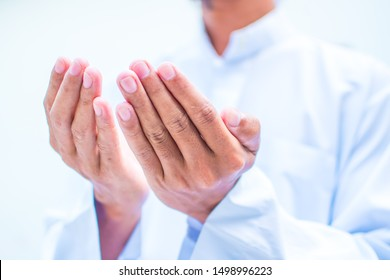 Muslim man in white session lift two hand for praying ,isolated on white background.concept for Ramadan, Eid al Fitr, eid ad-ha, meditation, islamic praying