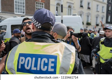 A Muslim man who was shouting abuse at counter protesters was removed by the police during the Al Quds Day rally, London, 10/06/18.