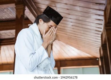 Muslim man worships and prays for Allah in