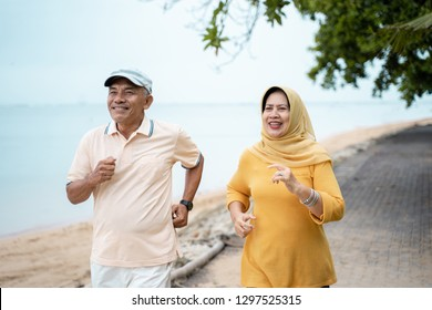 muslim mature couple doing jogging together in the morning