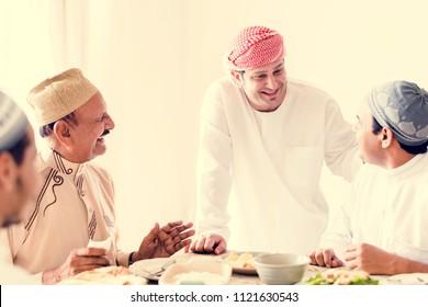 Muslim men celebrating ending of Ramadan