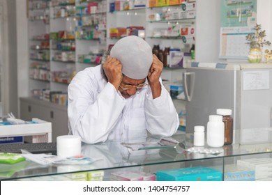 Muslim men have problems to be stressed and worried in the pharmacy, pondering to use consciousness to find a solution.