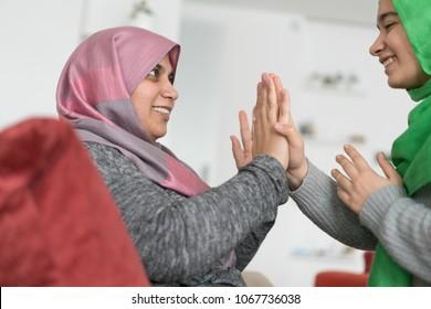 Muslim Mother and Daughter Bonding