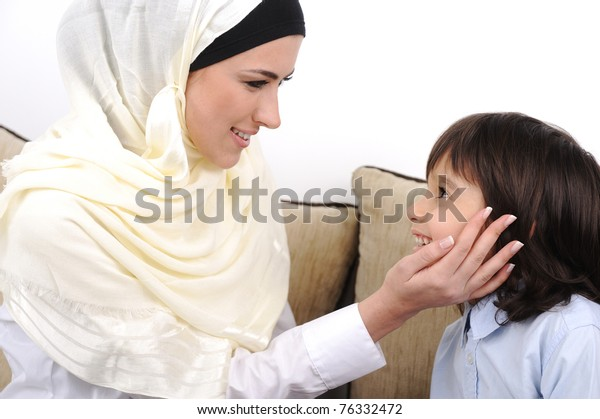 Muslim mother and son relaxing at the home