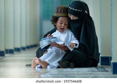 Muslim mother teaches her son to read Arabic, relationship between Muslim mother and child, Mothers day