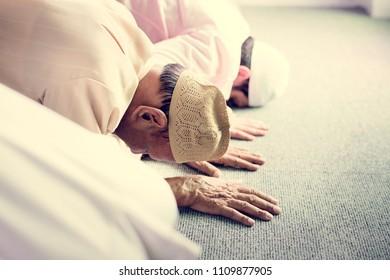 Muslim people praying in Sujud posture
