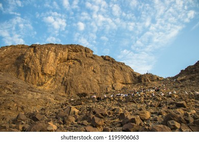 "Muslim pilgrims climb the Mount of light ""Jabal An-Nour"" where located the Hira cave. Place of first revelation to Prophet Muhammad"