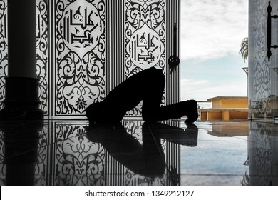 The muslim prayer for god in the mosque